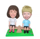 Custom Baby Bobble Heads Playing The See Saw Children's Memorial