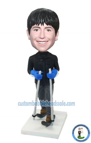 Sport bobbleheads Male Skiing On Ice With Gloves On Hands-Photo