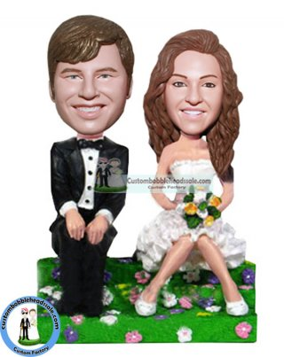 Groom And Bride Sitting On The Grass Bobbleheads Wedding